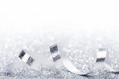 Błyszczący srebni faborków kędziory Zdjęcia Royalty Free