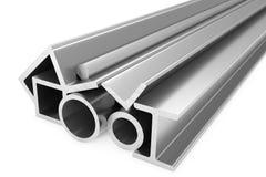 Błyszczący staczający się stalowi metali produkty na bielu Zdjęcie Stock