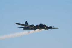 B-17 Flying Fortress with smoke trail stock image