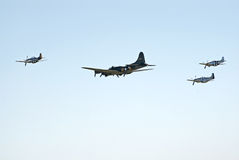 B-17 and three P-51's fly in formation stock image