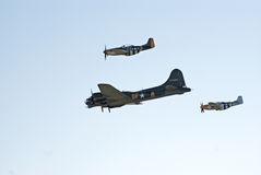 B-17 and two P-51's fly in formation Stock Photo