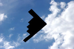 B-2 Stealth Bomber Fly-Over. The ominous, bat-like shape of the B-2 Stealth Bomber as it roars overhead just after take-off from Whiteman Air Force Base, Knob Stock Image