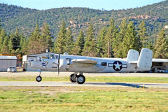 B-25 Medium Bomber. This is a B-25 Mitchell medium bomber taking off at Big Bear Lake, California, airfield after the air show stock image