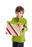 bärande barnjulgåva Arkivfoto