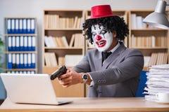 Błazenu biznesmen pracuje w biurze Zdjęcie Stock