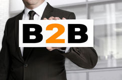 B2b sign is held by businessman concept Stock Images