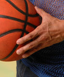 B-Ball. Male hand holding a basket ball Royalty Free Stock Photo