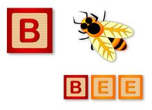 B Is For Bee. Text with sliced apple Royalty Free Stock Image