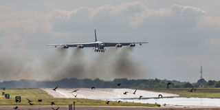 B52 bomber over runway Stock Photo