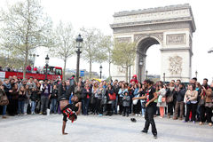 B-boy doing some breakdance moves. In front a street crowd, at Arch of Triumph, April 27 2013, Paris, France Stock Photos