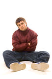 B-boy sitting on the floor. Isolated on white Royalty Free Stock Photography