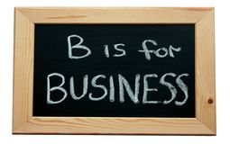 B is for Business. Black wooden framed chalkboard with a business message royalty free stock photos