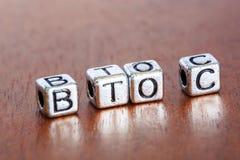 B2C (Affare--consumatore), concetto di finanza di affari con metallo immagini stock