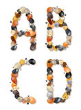 A,B,C,D. Letters of pebbles Stock Photos