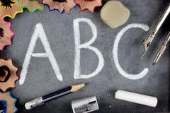A B C letters and school stuff on blackboard. Education concept. A B C letters and school stuff on blackboard royalty free stock photo
