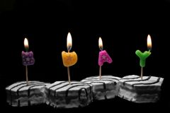 B-day. Small cakes with letters spelling b-day Royalty Free Stock Images
