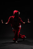 B-girl dancing. Against black background Royalty Free Stock Images