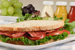 B.l.t sandwich and fruits Royalty Free Stock Photography
