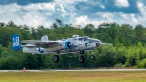 B25 landing at Air Legends show. Peterborough, Ontario, Canada - July 27, 2018: The B25 bomber 'MAID in the SHADE' of the Commemorative Airforce royalty free stock images