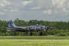 B17 Landing. PETERBOROUGH, ON, CANADA - JULY 15, 2017: Vinatge B17 flying fortress bomber lands at Peterborough airport. The aircraft was part of Peterborough royalty free stock images