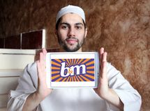 B&M European Retail Value logo. Logo of B&M European Retail Value on samsung tablet holded by arab muslim man. B&M Bargains is now one of the leading variety Royalty Free Stock Images