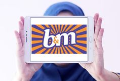 B&M European Retail Value logo. Logo of B&M European Retail Value on samsung tablet holded by arab muslim woman . B&M Bargains is now one of the leading Stock Photos