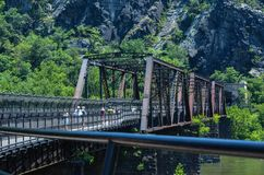 B&O Railroad Bridge in Harpers Ferry West Virginia allows both passenger and train traffic.  royalty free stock photography
