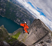 B.A.S.E. jumper in wingsuit jumps at Kjerag