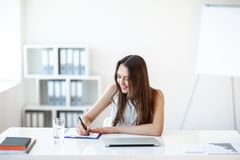 B usiness woman working in office with documents royalty free stock photos