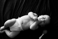 B&W Baby. Innocent baby on a black background Royalty Free Stock Image