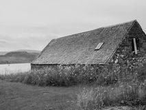 B&W barn by the waterside Stock Photo