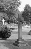 B&W Cross in the cemetery Royalty Free Stock Image