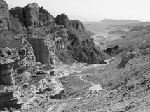 B&W desert mountains cliffs. Black and white stone desert mountains cliffs, Arava, Negev desert, Israel Royalty Free Stock Photography