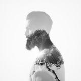 B/w double exposure portrait of a bearded guy and tree Royalty Free Stock Photo