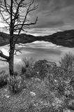 B&W fine art of still lake. A fine art black & white image of the reservoir at Painted Hills in Oregon Stock Image