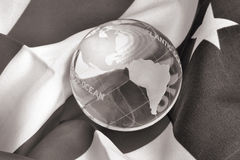 B & W Glass Globe on American Flag stock images