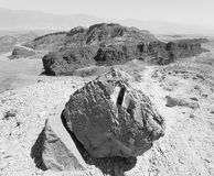 B&W huge rock desert mountains trail marking. Royalty Free Stock Photo