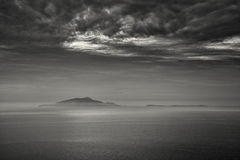 B&W image of mist surrounding the Italian islands of Isola d'Isc Stock Photo