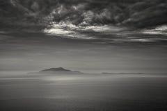 B&W image of mist surrounding the Italian islands of Isola d'Isc Stock Photo