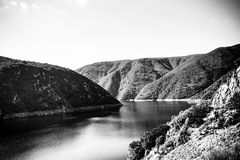 B&W Inlet to Kouga Dam. The Kouga Dam is an arch dam on the Kouga River about 21 km west of Patensie in Kouga Local Municipality, South Africa royalty free stock photography