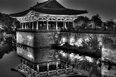 B&W korean temple reflection in pond dark contrast Royalty Free Stock Photography