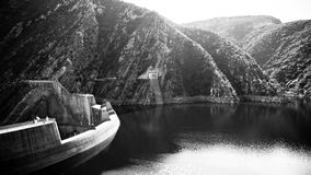 B&W Kouga Dam. The Kouga Dam is an arch dam on the Kouga River about 21 km west of Patensie in Kouga Local Municipality, South Africa royalty free stock photo