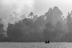 B&W lake. Couple fishing when they were together Stock Photography