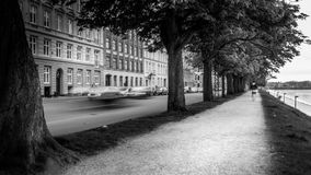 B&W long exposure scenic of roadpath and active road in city. Taken in the city of Copenhagen, Denmark. On May 7, 2017 Stock Photography