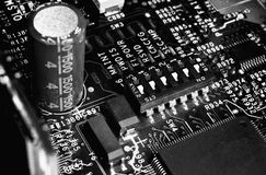 B/w motherboard with jumpers. Electronic microcircuit (server motherboard) with jumpers black and white background Royalty Free Stock Photos