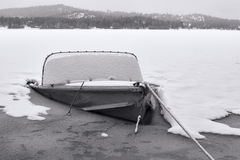 B&W of old boat partly sunk. Royalty Free Stock Photos