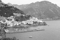 B&W panoramic view of the town and port of Amalfi, Italy, with Lattari Mountain at the back stock images