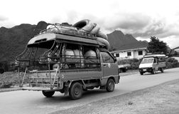 B-W photo of Adventure traveller car in Laos. VANG VIENG LAOS - AUGUST 9: B-W photo of Adventure traveller car on August 9,2015 in Vang Vieng, Laos Royalty Free Stock Photography