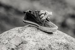 B&W of shoe on a rock. Royalty Free Stock Photography