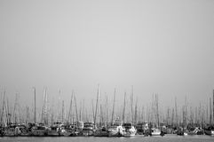 B&W shot of many ships sitting in harbor. A b&w of a large number of ships sitting close together on the sea in a harbor Royalty Free Stock Photography